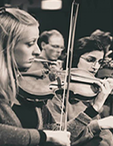 Alina Hiltunen (Leader) and members of The Collaborative Orchestra violin section.